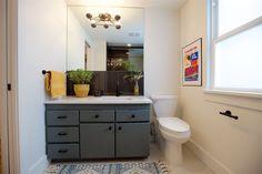 Boise Boys | Timber And Love | Luke Caldwell | HGTV | Realty | Mid Century modern | home renovation | Design | Boise Idaho | Bathroom | gray cabinets | modern | gold light fixture | black tile backsplash