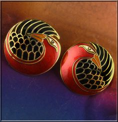 Beautifully created in cloisonne enamel of deep iridescent red, black, and gold, they are  a standout pair in any era.   All of their colors and