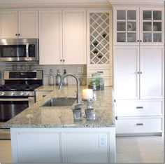 molding is nice to break up cabinets made by an Amish carpenter – how lucky is that?  Living in Pennsylvania does have its advantages – where else can you hire an Amish carpenter??  Granite countertops and tumbled stone backsplash.