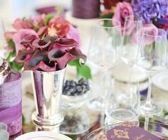 Burgundy Calla lilies placed in a silver bud vase, surrounded by blooms in pink and purple hues, bring color and dimension to a table setting. Classic Romantic Wedding, Romantic Weddings, Real Weddings, Calla Lily Centerpieces, Wedding Decorations, Table Decorations, Purple Hues, Wedding Photos, Wedding Ideas