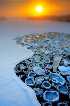 Pancake Ice ~ ice crystals that form in very cold water that is moving too fast to let the ice form into a sheet. Antarctica