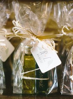 "PopSugar says: offer a wedding treat your guests will love! Check out idea - Olive Oil! ""Olive oil is a kitchen essential, and your guests will appreciate the practicality of this favor."" Photo by Clary Photo via Style Me Pretty Olive Oil Wedding Favors, Olive Oil Favors, Wedding Favors Cheap, Wedding Favours, Diy Wedding Food, Wedding Gifts For Guests, Wedding Tips, Wedding Planning, Wedding Blog"
