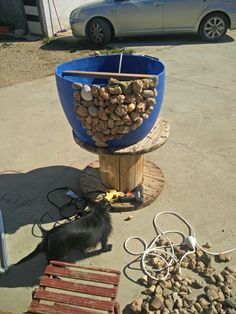 Reciclando bidones y piedras