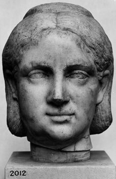 Marble portrait head from a statue of a woman.