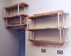 A wall mounted shelving unit made from copper pipe and reclaimed wood. The shelving unit displayed is made from 28mm diameter copper pipe and wooden shelves which are stained 'light pine' and have a 'clear wax' finish applied. | eBay!