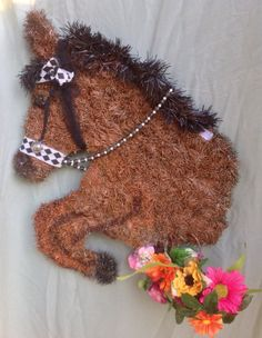 My one of a kind horse head wreath of a horse taking a jump.  This one is available for purchase