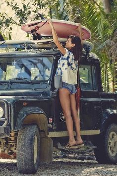 picture perfect ...... right car.... girl ..... and she's surfing too ..... there is a god ;)