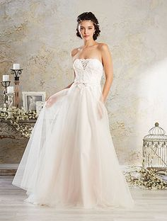 Alfred Angelo Style 8564: soft a-line strapless wedding dress with sheer plunging neckline