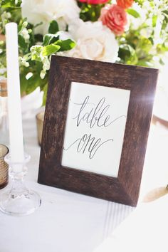 Calligraphy.  Parris Chic Boutique. Photography: Kay English Photography - kayenglishphotography.com  Read More: http://www.stylemepretty.com/2014/06/24/home-decor-inspired-wedding-details/