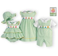Festive childrens Easter outfits of green and white striped cotton seersucker. Hand-smocked bodices are decorated with Easter egg and chick embroider