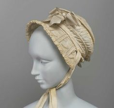 Bonnet | Dimensions: Overall (approximate due to distortion): 24 x 20 x 13 cm (9 7/16 x 7 7/8 x 5 1/8 in.) | Cotton, cane, gauze lining, and grosgrain ribbon | Accession Number 43.1587