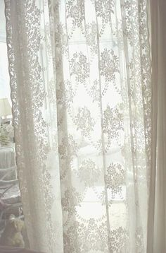 Gorgeous french lace curtains with roses and trellis.  Two pairs available.  $68 pr SOLD