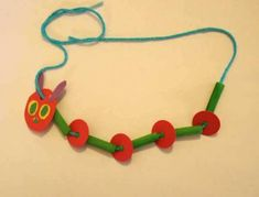 Eric Carle - Very Hungry Caterpillar necklace craft - green-dyed pasta, yarn, paper scraps Kids Crafts, Animal Crafts For Kids, Spring Crafts For Kids, Book Crafts, Family Crafts, The Very Hungry Caterpillar Activities, Hungry Caterpillar Craft, Thinking Day, Hungry Caterpillar