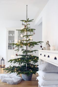 "Love the simplicity of this natural ""Charlie Brown"" Christmas tree. Fits right in with my farmhouse christmas decor. Minimalist Christmas, Scandinavian Christmas, Modern Christmas, Christmas Love, Country Christmas, Beautiful Christmas, Winter Christmas, Merry Christmas, Charlie Brown Christmas Tree"