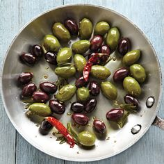 Heating herbs and spices in oil extracts their flavors, making it easy for olives to take on their aromatic essence.