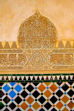 Colorful tile and ornate carvings decorate the Alhambra, an 11th Century Moorish palace in Granada, Spain