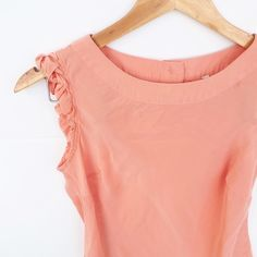 Banana Republic braided shoulder top Peach/coral colored top with braided arm detail and 3 buttons on back. Small stitch issue as shown in 3rd pic. Banana Republic Tops Blouses