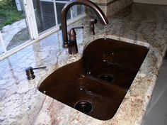 Chocolate Undermount Sink And Bronze Faucets