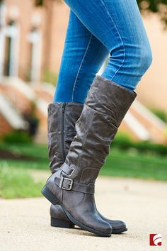 "This fall, go grey in riding boots. Choose a pair that has unique buckle detailing to show off your classic style. They're perfect with everything from jeans to sweater dresses; running errands or on a romantic date night. See more about the ""Joey"" shown here or explore all of our boot styles on famousfootwear.com."