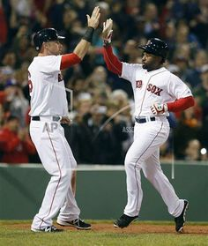 Rays Red Sox Baseball Boston Red Sox's Will Middlebrooks, left, celebrates with teammate Jackie Bradley Jr. after both scored on a two-run single by David Ortiz in the fifth inning of the second baseball game of a doubleheader against the Tampa Bay Raysn Boston, Thursday, May 1, 2014. (AP Photo/Michael Dwyer)