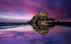 The Mont Saint Michel is one of France's most iconic attractions and a UNESCO World Heritage Site visited by more than 3 million people annually. It is famously located on a rocky tidal island almost a mile off coast of Normandy, and about 150 miles from Paris.