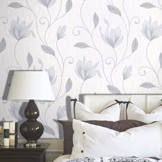 This beautiful Floral Glitter Wallpaper will add a stylish finishing touch to any room. The design features a classic floral trail in complimentary tones of grey and silver, with matte, metallic and glitter elements for a contemporary finish. This is overlaid on a lightly textured cream background that is infused with silver glitter.