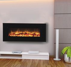 "Onyx Touchstone 50"" Electric Wall Mounted Fireplace.  This could look sleek with clean lines, even in my traditional setting."