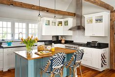 This breakfast room was turned into an open kitchen suited for enthusiastic cooks with two young children, featuring an extra-large salvaged cast-iron sink.