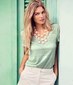 Such a simple, classy look. Take an aqua T-shirt and pair it with simple white bottoms. Pair with a bold statement necklace like this one.