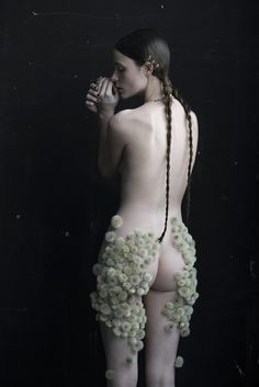 """Flower artist Duy Anh Nhan Duc has collaborated with photographer Isabelle Chapuis for two poetical series : """"Dandelion"""" and """"Etamine"""". The first series of portraits pays tribute to dandelions through women's portraits, full of finesse. The second one focuses on a man dressed up and masked by carnations', anemones', iris' and chrysanthemum's petals"""