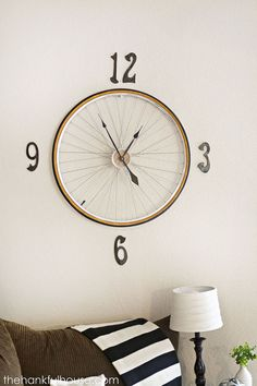 You should make this vintage Bicycle Wheel Clock for your house