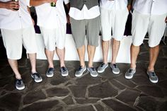 groomsmen in shorts - maybe too long though.. The shorter ones look smarter