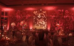 Nice lighting and graphics on the wall! Unique idea for a wedding reception