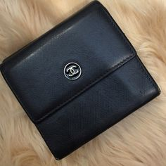 CHANEL CC Button Trifold Wallet Authentic! A decent and elegant style from Chanel. Features a separate bill, coin & 6 card slots compartments. Leather remains mostly smooth and clean. Shows a barely noticeable wear and scuff. Front snap closure is a little loose fitting but still works. Very minor peeling on the gold inside logo. Purchased from Japan. PRICE FIRM. CHANEL Bags Wallets