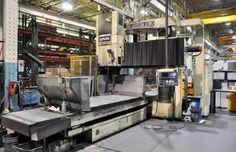 SNK BRIDGE TYPE CNC VERTICAL MACHINING CENTER - FANUC, BT50 TOOL HOLDERS