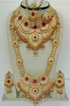 Deep #Pink and Off #White Stone Studed Bridal #Necklace Set @ $116.34 | Shop @ www.utsavfashion....