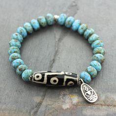 Dharmashop.com - Dzi Bead Buddha and Czech Bead Wrist Mala, $48.00 (http://www.dharmashop.com/dzi-bead-buddha-and-czech-bead-wrist-mala/)