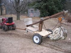 Homemade towed crane constructed from a concrete mixer frame, channel, pipe, angle iron, and a chain hoist. Farm Tools, Garden Tools, Atv Implements, Crane Lift, Block And Tackle, Garden Tool Organization, Welding Cart, Tool Room, Ideas