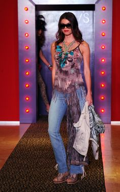 A model walks the runway at the Steven Tyler & Andy Hilfiger Host Andrew Charles' Fashion Show at Macy's Sherman Oaks on April 7, 2012 in Sherman Oaks, California.