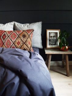 Moody bedroom with Vintage Kilim Pillow.