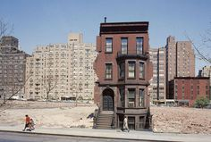 A solitary brownstone on land being cleared for a 20-storey block in 1959. New York.  Photograph: Dmitri Kessel/Getty Images The Guardian