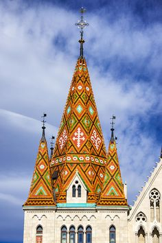 Colorful steeple of Matthias Church, Budapest, Hungary. The roofing tiles are pyrogranite ceramics from the Zsolnay factory. Malta, Austro Hungarian, Cathedral Church, Central Europe, Place Of Worship, Metal Roof, Landscape Photos, Cladding, Beautiful Day