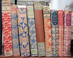 I dream of decorating with vintage books. And actually having beautiful hard covered books to read.