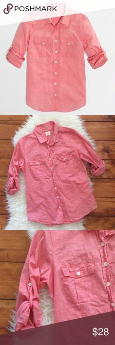 """J. Crew Voile Camp Shirt in Perfect Fit Excellent condition J. Crew Voile Camp Shirt in Perfect Fit. Size Medium. Strawberry colored. Roll up sleeves, button tabs. 100% cotton. Bust 38"""", length 27"""", shoulder seam to shoulder seam across the back 15"""". No trades, offers welcome. J. Crew Factory Tops Button Down Shirts"""