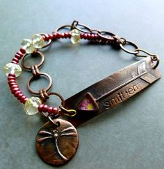 """Smitten/ This copper chain, in silver,  on a """"too small"""" silver necklace as an extender."""