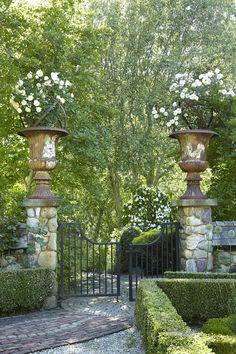 Urns adorn a formal garden entrance Formal Gardens, Outdoor Gardens, Modern Gardens, Courtyard Gardens, Garden Modern, The Secret Garden, Secret Gardens, Garden Entrance, House Entrance