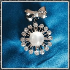 "Vintage Rhinestone and cabochon brooch. This brooch is from the 1950s! Moonstone  cabochon, surrounded by rhinestones. Dangles from a silver bow. Measures 2"". Absolutely gorgeous. Vintage Jewelry Brooches"