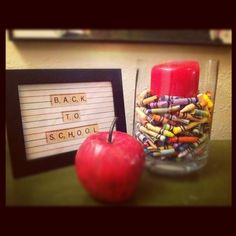 Back to school decor-Use broken crayons for a hurricane filler!