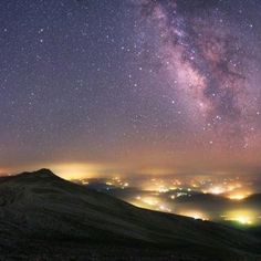 Mountain overlook in Uludag National Park in Turkey. The pink clouds of the Milky Way stretches across the sky above the man-made pockets of hazy lights from the towns and villages below. of the city's pockets of light fields...  Photograph courtesy Tunç Tezel, APOY/Royal Observatory (Info gathered among 3 Pins:) - DdO:) - http://www.pinterest.com/DianaDeeOsborne/universe-lights/