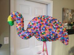 Bejeweled Flamingo. Dollar store flamingo, plastic beads, E6000 glue, and lots of patience.